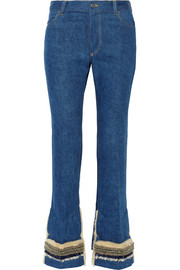 Faux shearling-trimmed embellished high-rise flared jeans