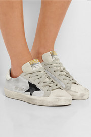 Distressed leather-paneled mesh sneakers