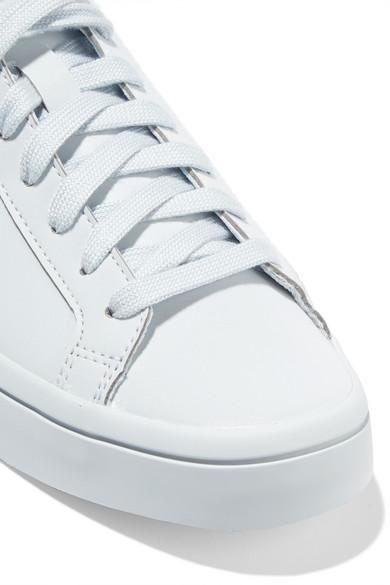 brand new 80d38 ab8d5 adidas Originals. Court Vantage Adicolor reflective coated mesh sneakers.  £26. Zoom In