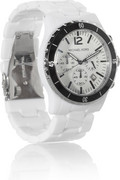 Michael Kors watch has a bracelet strap, a white face, three sub-dials...