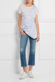 The Kick cropped distressed flared jeans