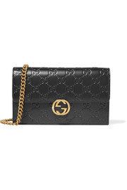 Icon embossed leather shoulder bag