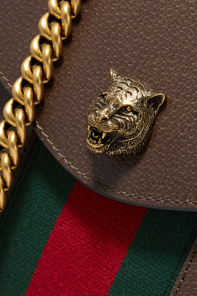 fc2759ca676828 Gucci. Animalier tasseled textured-leather shoulder bag. $1,194. Zoom In