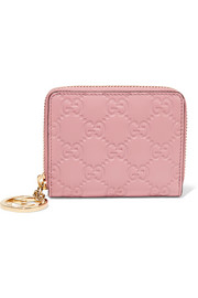 Icon embossed leather wallet