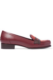 Cites crocodile-trimmed leather and suede loafers