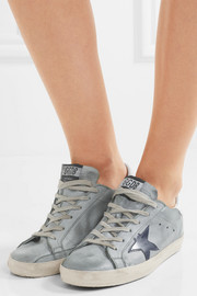 Superstar distressed leather-paneled suede sneakers