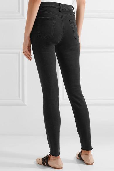 271525b981e3 J Brand. Carolina distressed high-rise skinny jeans.  155.86. Play