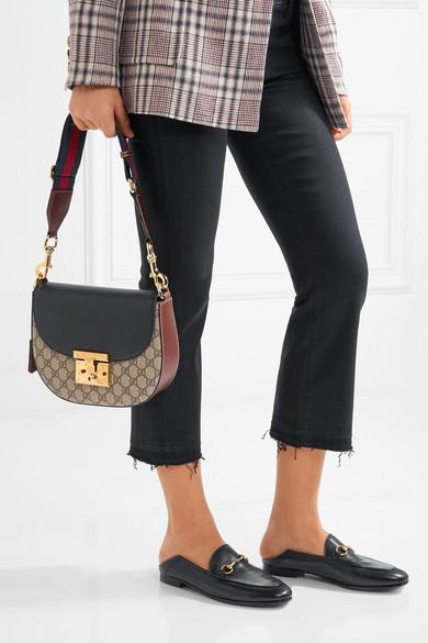 fcf0f87ec Gucci. Padlock Saddle medium leather-trimmed coated-canvas shoulder bag.  $1,980.00. Play