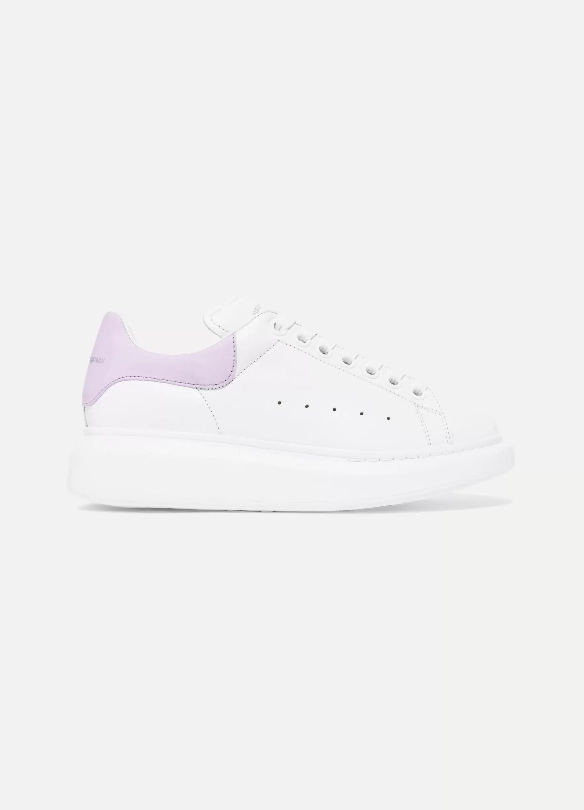 White Suede-trimmed leather exaggerated