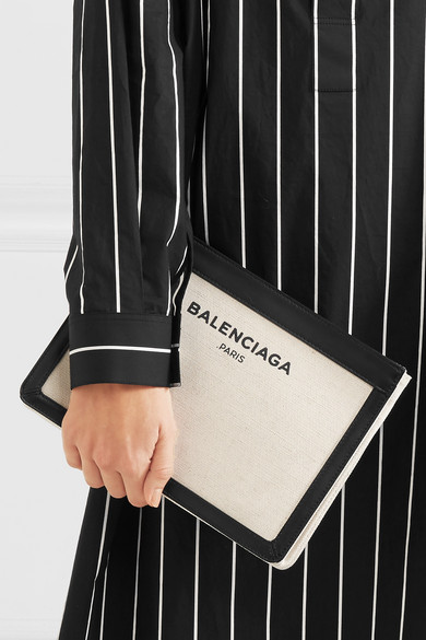 07b358bd91 Balenciaga. Navy Pochette leather-trimmed canvas shoulder bag. HK$4,620.  Zoom In