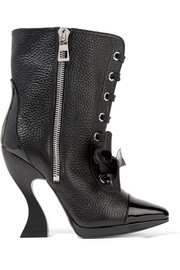 Patent-trimmed textured-leather boots