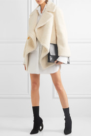 Shearling and cable-knit coat