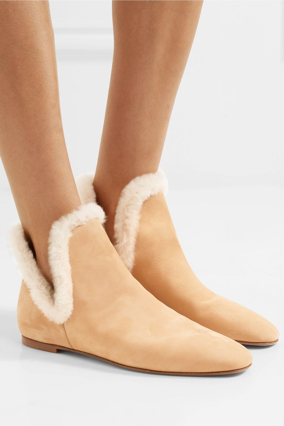 The Row Eros shearling-trimmed suede ankle boots