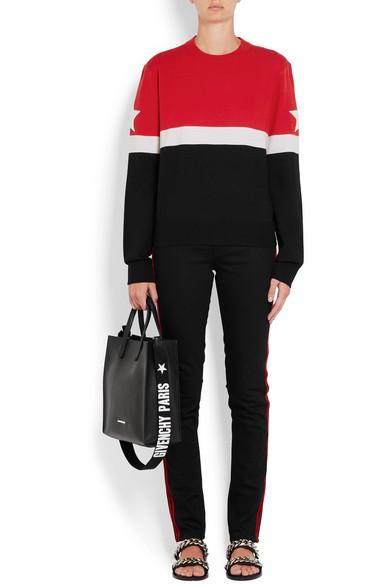 a2f4ecb72e6 Givenchy. Pull en laine mélangée rayé à appliqués