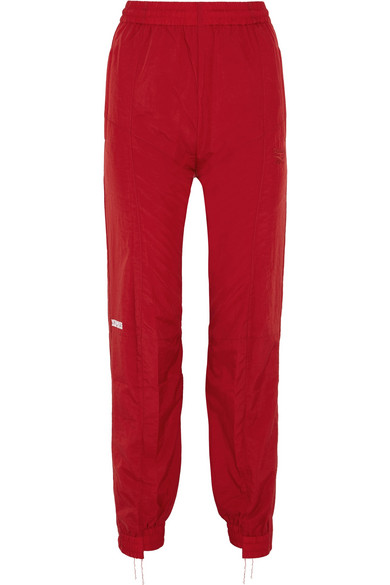 + Reebok Distressed Embroidered Shell Track Pants in Red