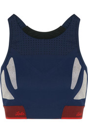 Snap printed perforated stretch-jersey sports bra