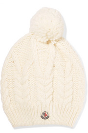 Pompom-trimmed cable-knit beanie