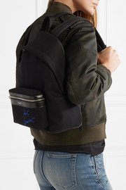 Leather-trimmed embroidered canvas backpack