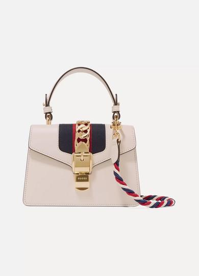 cb2122666f4 Gucci. Sylvie mini chain-embellished leather shoulder bag