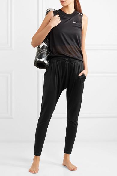 almohadilla Juramento Navidad  Nike | Flow Lux Dri-FIT stretch-jersey tapered pants | NET-A-PORTER.COM