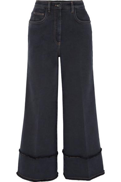 Miu Miu Verkürzte, hoch sitzende Jeans mit weitem Bein und Fransen