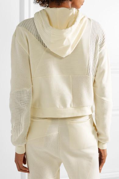 McQ Alexander McQueen Kapuzenoberteil aus Baumwolle mit Strickeinsätzen und Schnürung