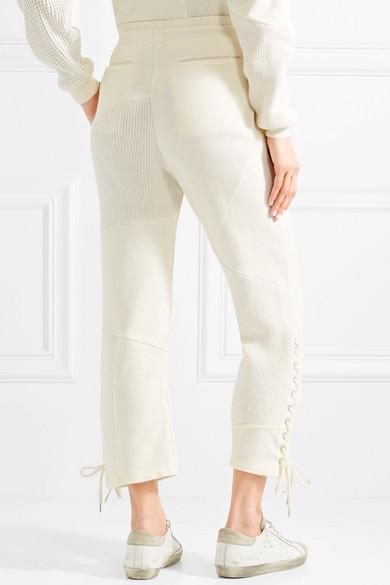 McQ Alexander McQueen Jogginghose aus Baumwolle mit Schnürungen und Strickeinsätzen