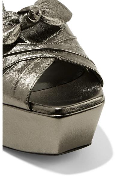 795fe5f1462 Saint Laurent. Farrah bow-embellished metallic leather platform sandals.   497.50. Play