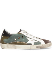 Superstar distressed printed canvas, leather and suede sneakers