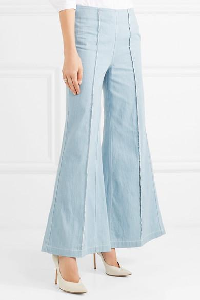 Paper London Encore hoch sitzende Jeans mit Fransen