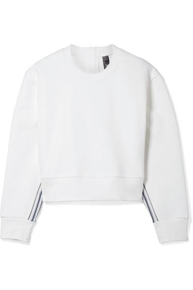 adidas by Stella McCartney Train verkürztes Sweatshirt aus Baumwolle mit Streifen