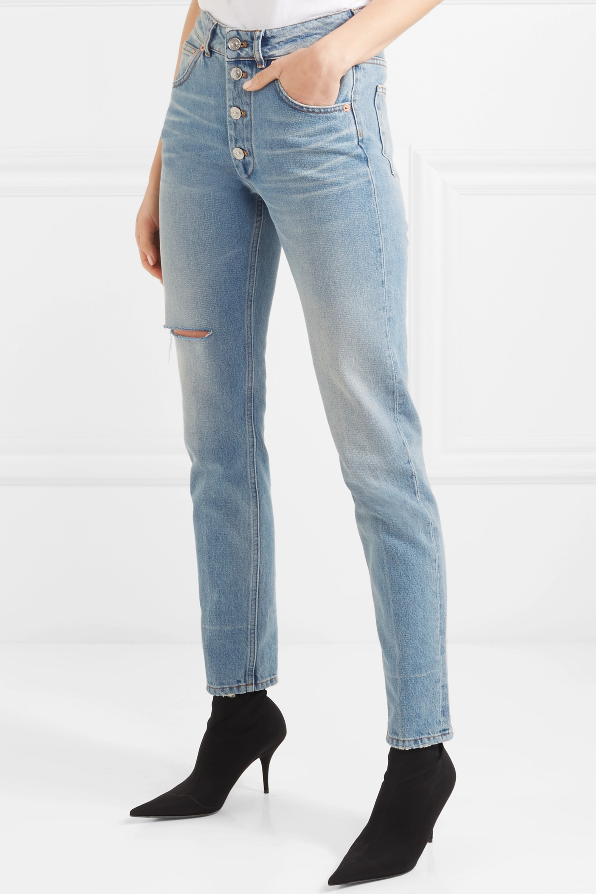 BALENCIAGA High-rise distressed slim-leg jeans