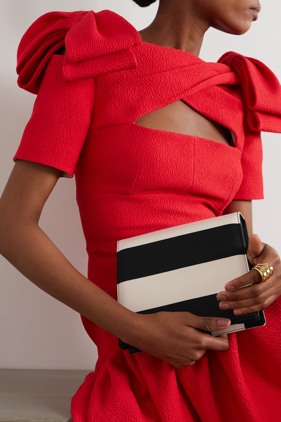EMILIA WICKSTEAD Striped satin clutch