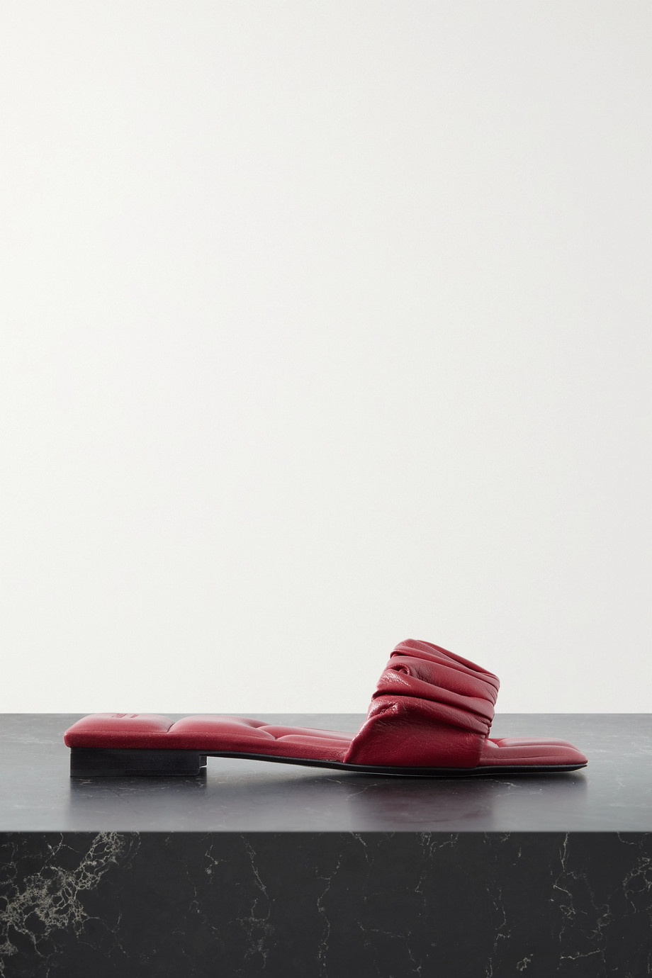 KHAITE Crete ruched leather slides