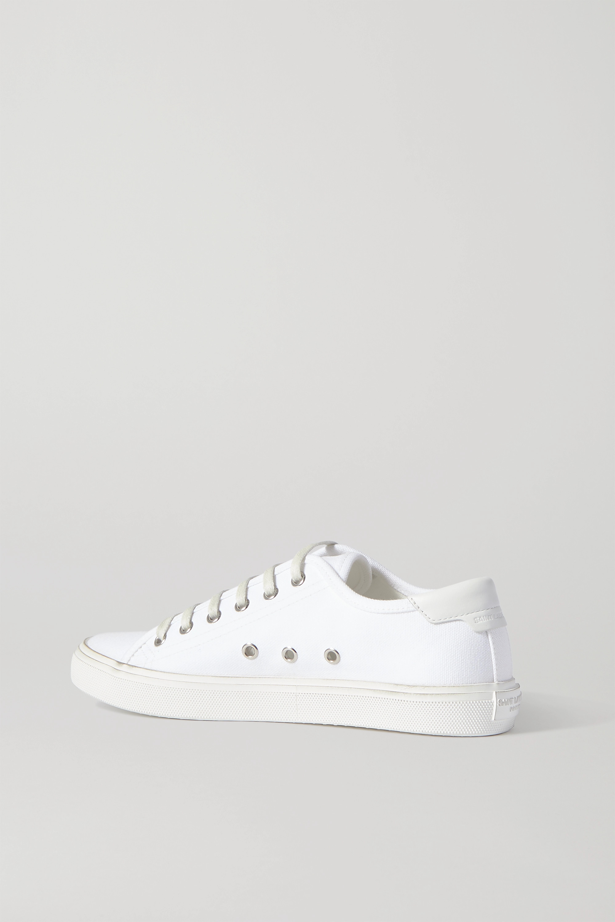 SAINT LAURENT Malibu leather-trimmed distressed cotton-canvas sneakers